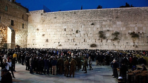 People gather at night during Shabbat at the Western Wall in Jerusalem