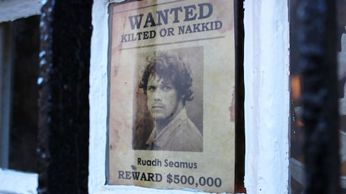 Wanted poster in window of character from Outlander TV Show