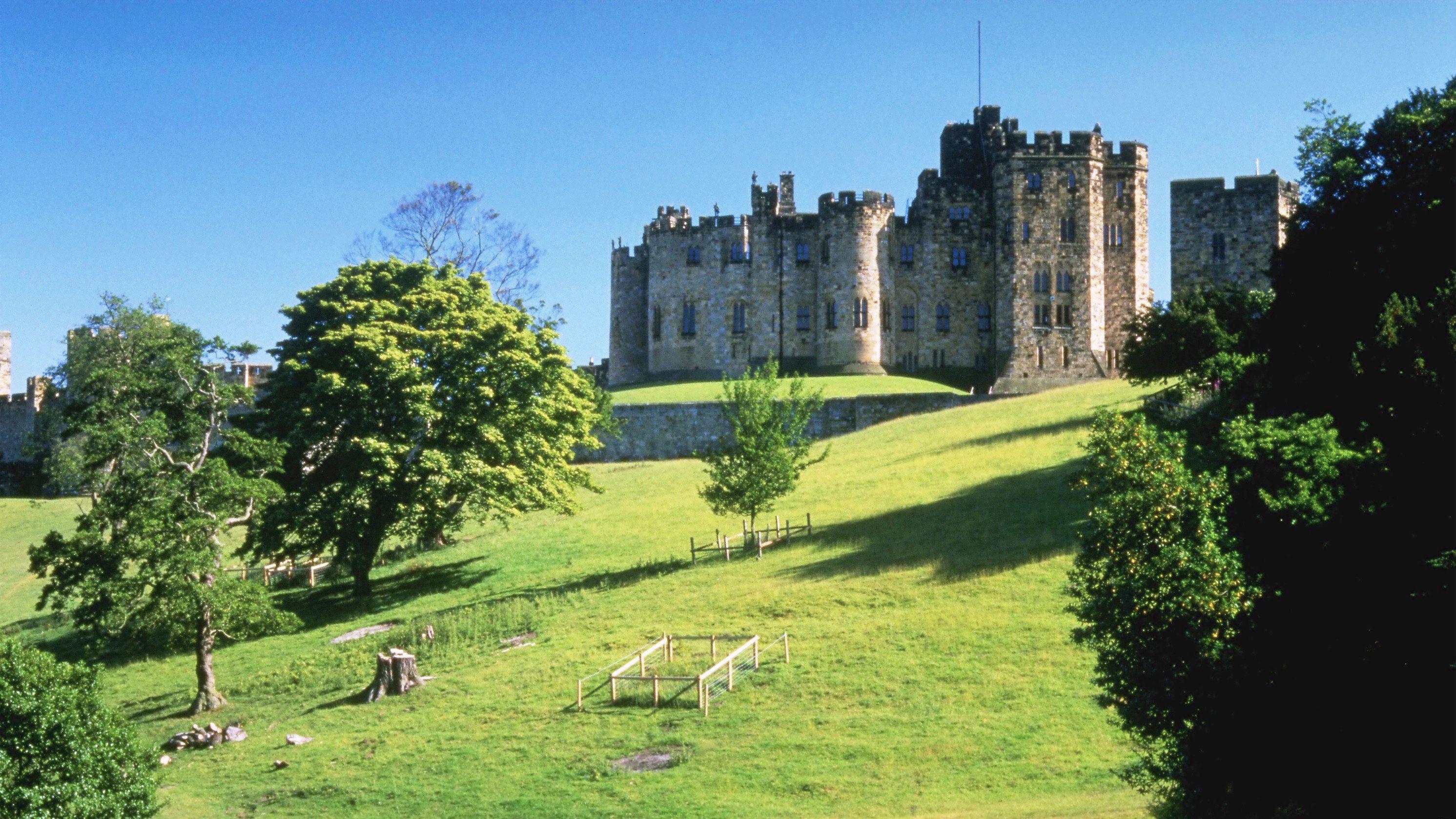 Alnwick Castle on hill in Scotland