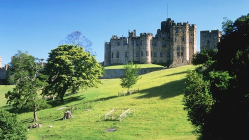 Alnwick Castle on hill in Scotland