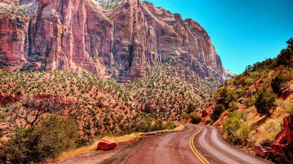 Show item 1 of 6. Road between the hills at Zion National Park