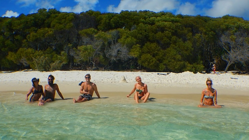 Four people on a beach in Queensland