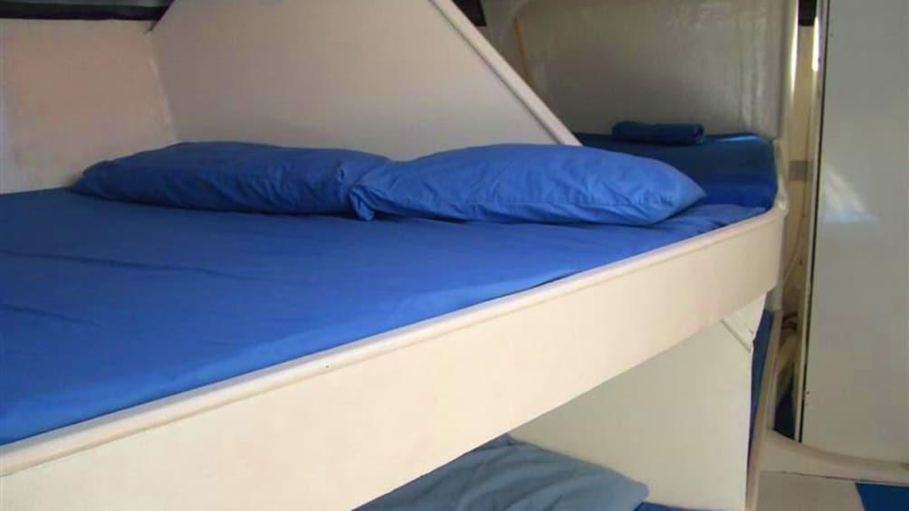Show item 4 of 5. Bunk in a Sailboat