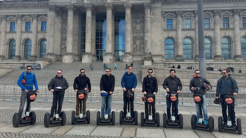 Row of segway riders in front of historical building in Berlin