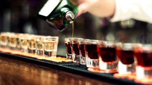 Jagermeister filling shot glasses