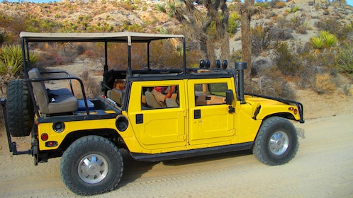 Yellow Hummer on a dirt road in Joshua Tree National Park in Palm Springs