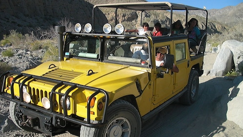 Smiling passengers on a Hummer tour in Joshua Tree National Park in Palm Springs
