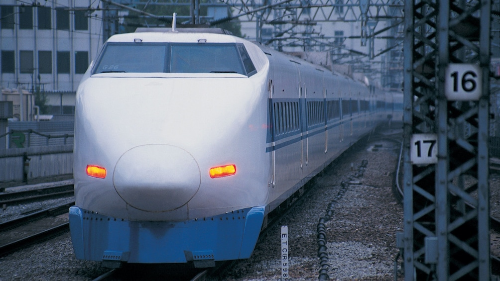 Bullet train traveling down track in Tokyo