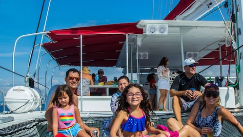 Family siting out in sun on catamaran in Taboga Island