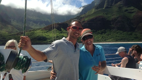 people smiling onboard boat in kauai