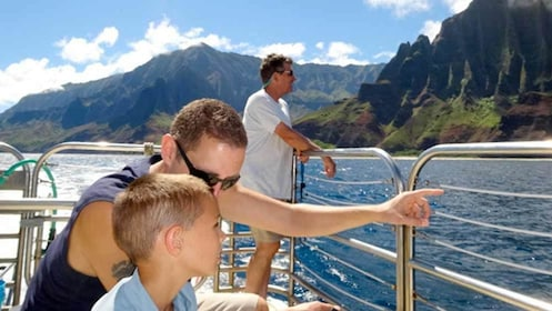 man and boy enjoying a view from a boat in kauai