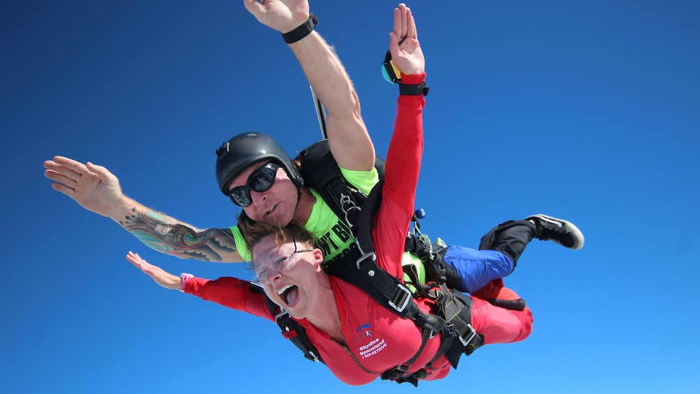 Show item 1 of 5. Woman skydiving with instructor over Atlanta