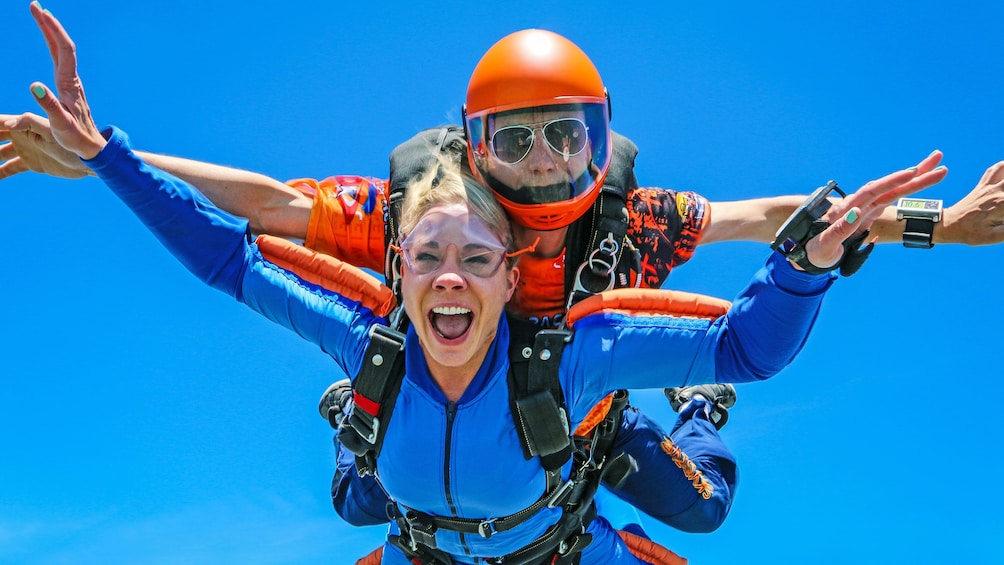 Show item 5 of 5. Woman skydiving with instructor over Atlanta