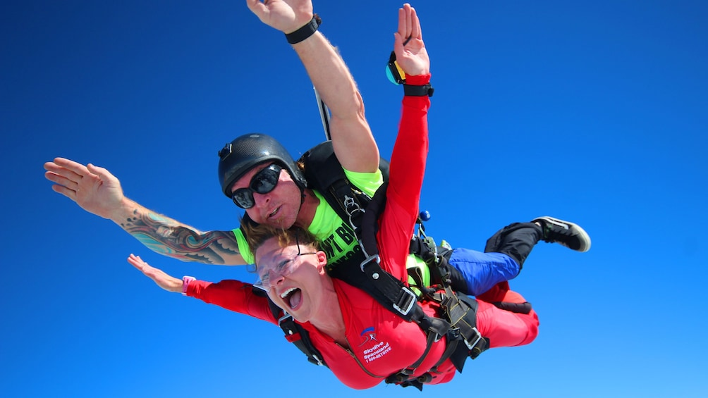 Show item 5 of 5. Tandem skydivers