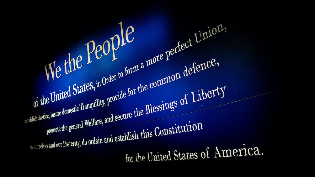 Show item 10 of 10. The beginning of the U.S. Constitution on the wall of the National Constitution Center in Philadelphia