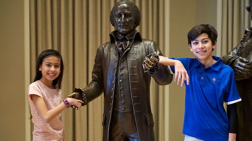 Children posing with statue in the National Constitution Center in Philadelphia
