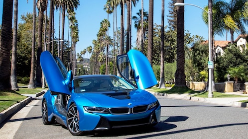 BMW i8 sport car on palm tree lined street in Beverly Hills