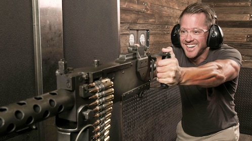 Man joyfully shooting a machine gun at a range in Las Vegas