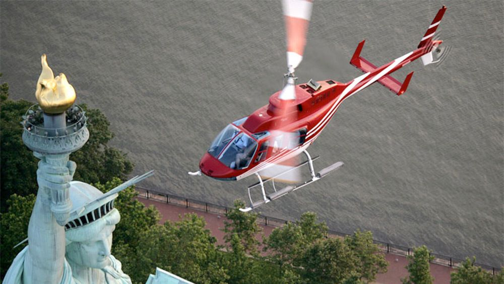 Helicopter flying near the Statue of Liberty in New York