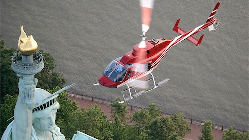 Helicopter tour above the statue of liberty in New York