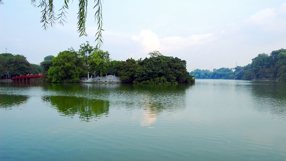 Show item 3 of 6. Shoreside view of Hoan Kiem Lake in Hanoi