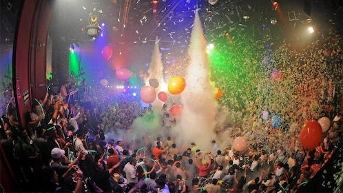 Balloons and fog fall on guests at the Coco Bongo in Cancun