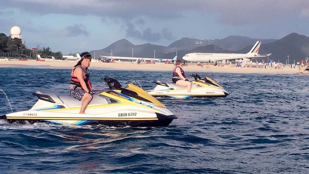 Show item 2 of 8. Group having fun jet skiing in St. Martin