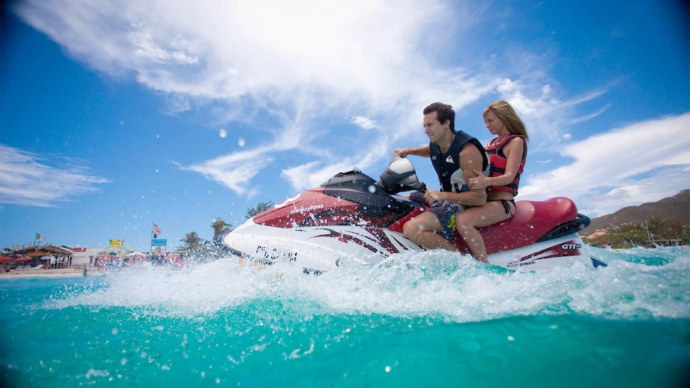 Show item 1 of 8. Vibrant view of a couple jet skiing in St. Martin