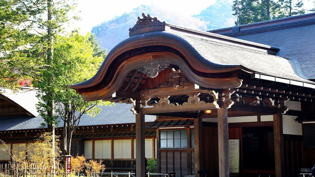 Elegant wooden roof and entrance way to building in Nikko