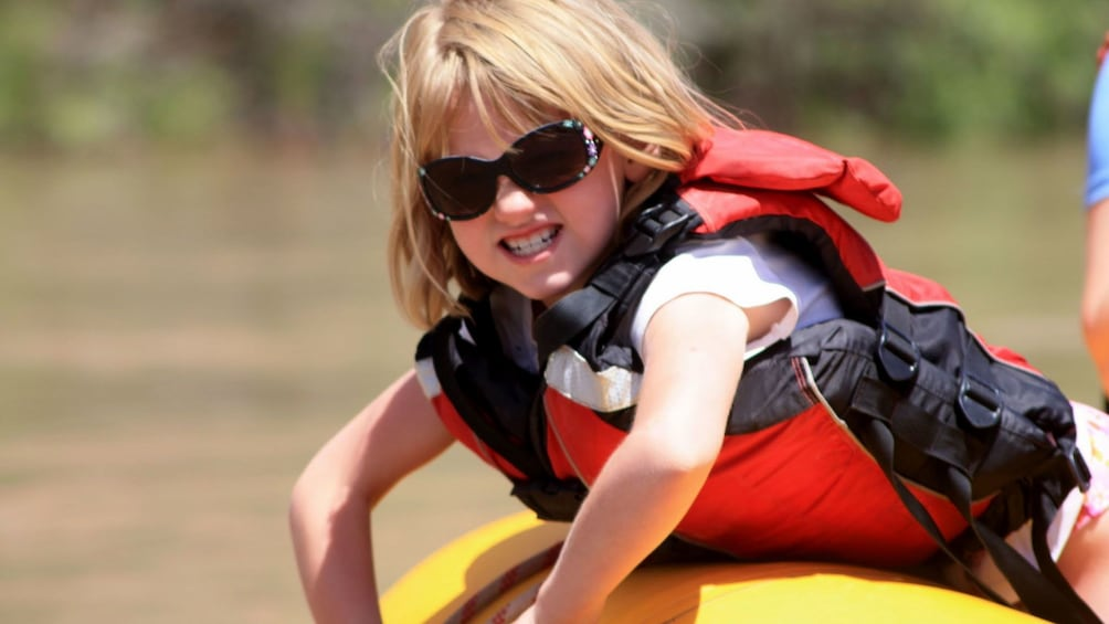 Young girl on a raft on a river in Utah