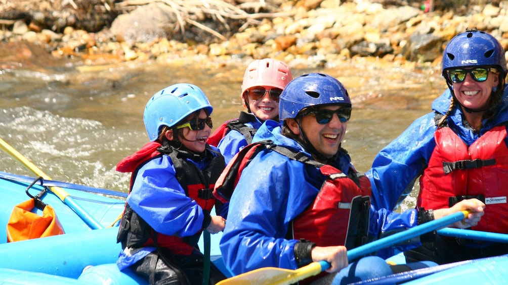Show item 2 of 5. Small kids enjoy paddle down Clear Creek in Denver