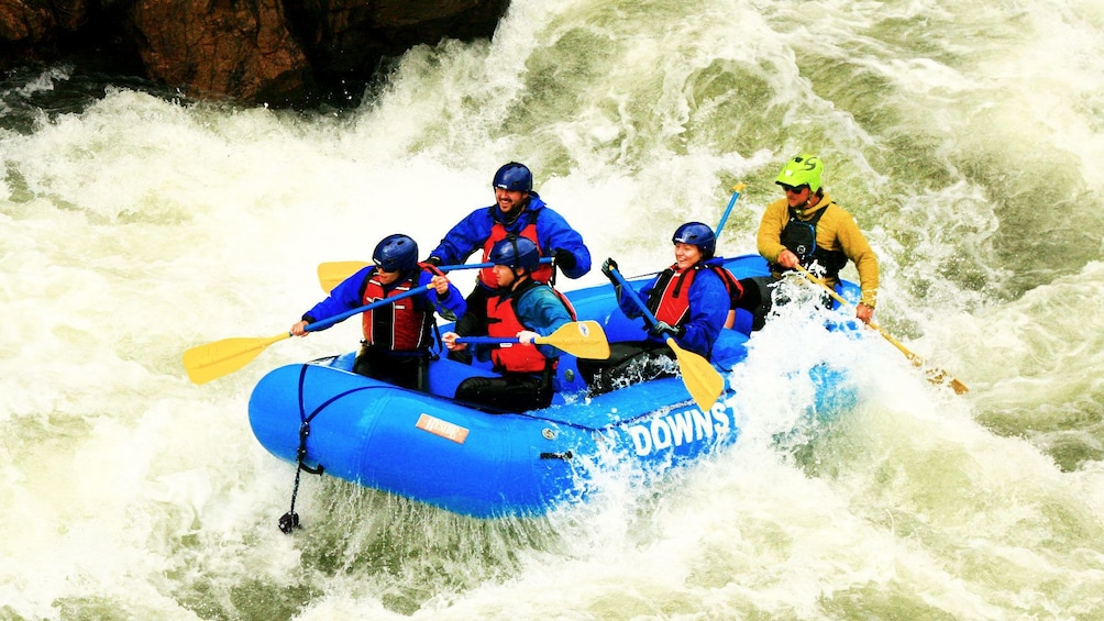 Show item 1 of 5. Rafters hitting rapids on Clear Creek with guide in Denver