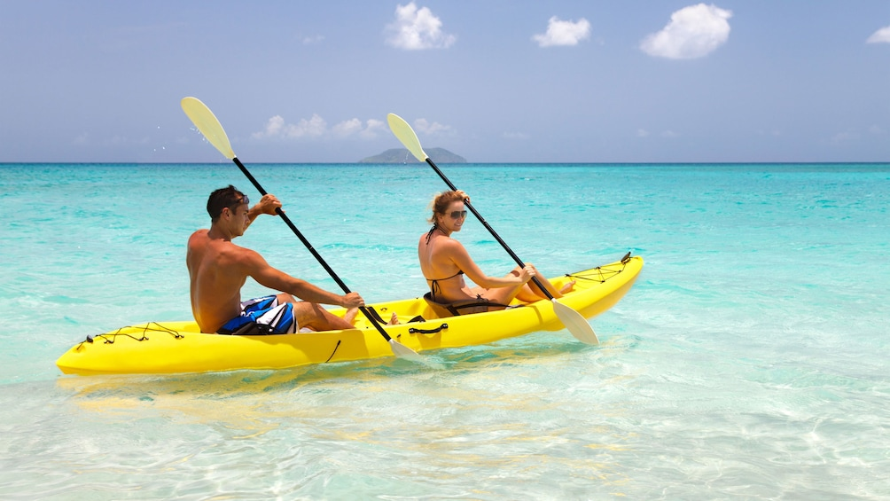 Show item 2 of 5. Sea kayaking couple in San Juan