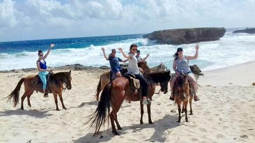 Tourists having fun on the horseback riding tour in Aruba