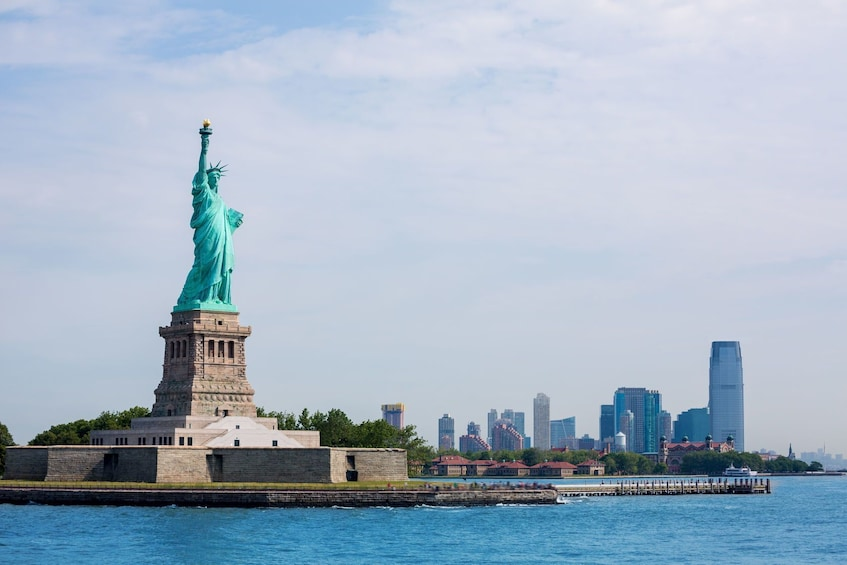Show item 3 of 8. Statue of Liberty & Ellis Island Tour with Express Bus from Midtown