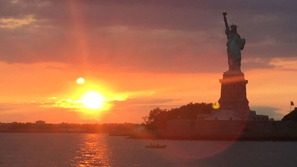 Show item 2 of 8. Statue of Liberty at sunset in New York