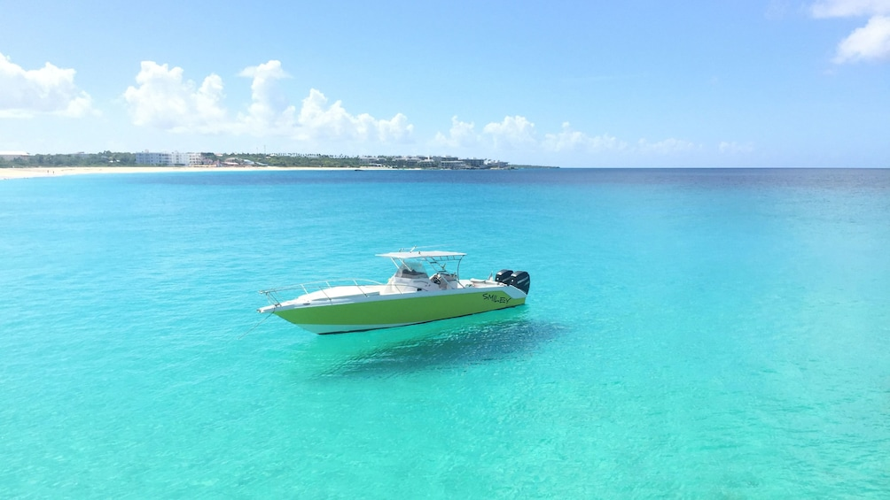 Show item 5 of 5. Boat anchored in clear blue water off the coast of St Martin