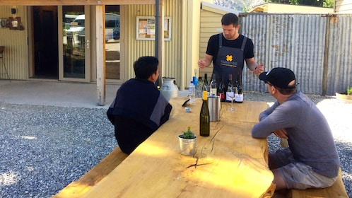 Staff talking to two men about wine in Queenstown