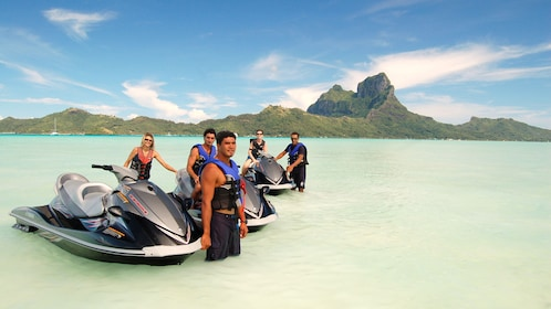 Group of people waiting in shallow water in Bora Bora