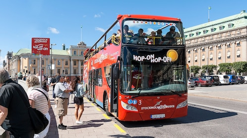 Red Buses Hop-On Hop-Off double decker bus parked on street in Stockholm