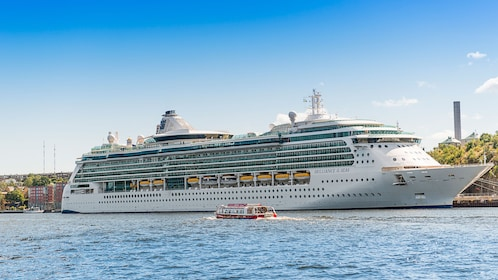View of cruise ship from Red Buses Hop-On Hop-Off double decker bus in Stockholm