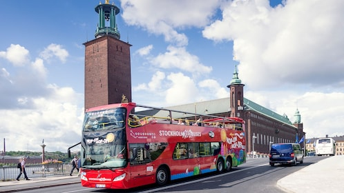 Red Buses Hop-On Hop-Off double decker bus driving down street in Stockholm