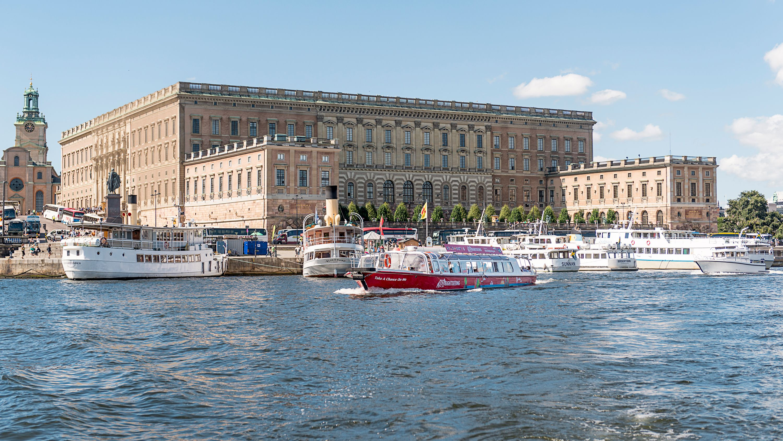 Hop-On Hop-Off Boat traveling down bay in Stockholm