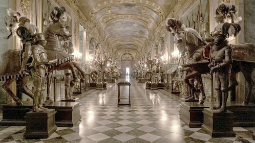 Hallway lined with suits of armor and jewelry in the Royal Palace in Turin
