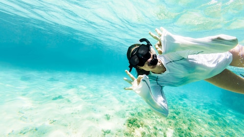 Woman snorkeling in the clear waters around Culebra Island