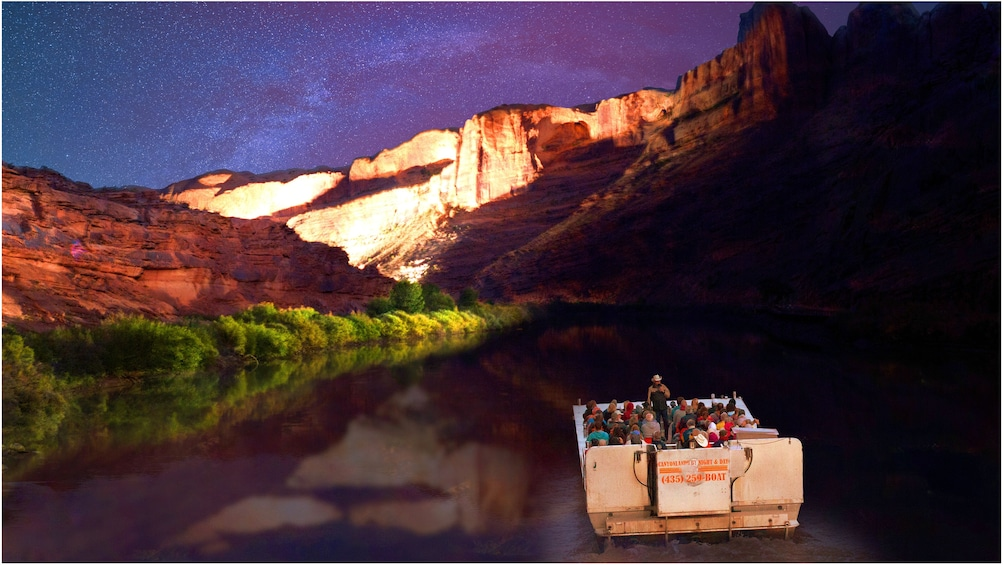 Show item 5 of 5. Night boat tour on a river in Utah with the Milky way