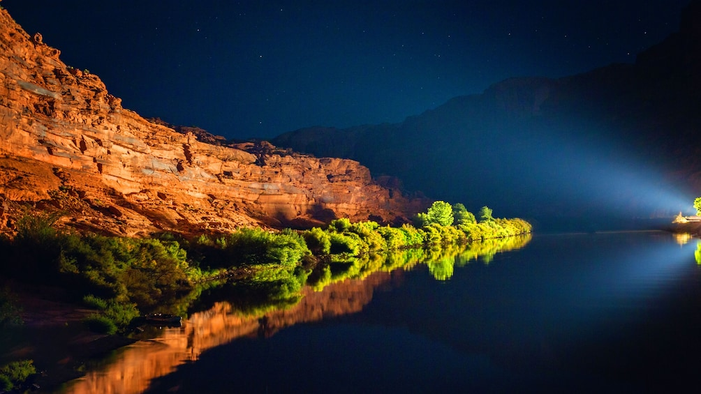 Show item 1 of 5. Night boat tour on a river in Utah