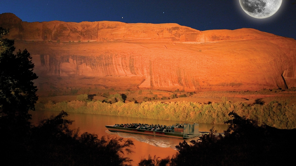 Show item 5 of 5. Night boat tour on a river in Utah with a fake moon