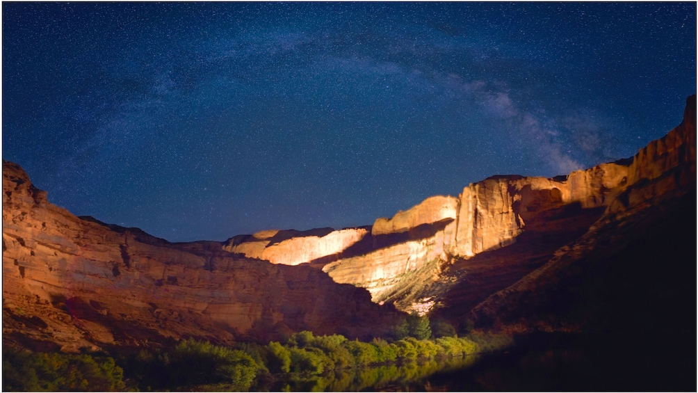 Show item 4 of 5. Night boat tour on a river in Utah with the Milky way