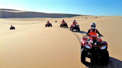 View of a group enjoying a quad bike tour in New South Wales Regional, NSW, Australia